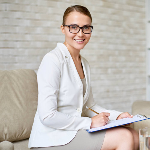 female therapist wearing eye glasses at the office