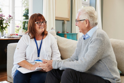 smiling female therapist with her old man client