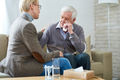 female therapist doing counseling to her old man client