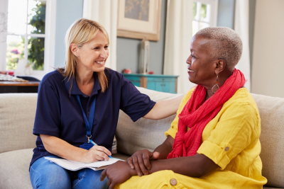 female therapist happy talking to her african client