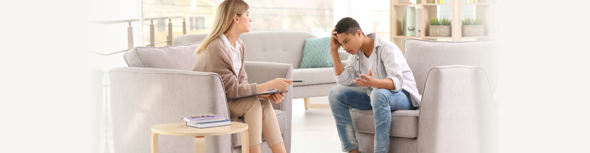 female therapist doing counseling to her teen client